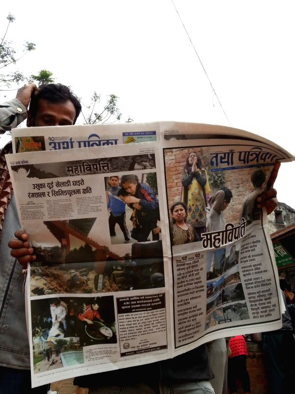 People read newspapers to learn about the earthquake in Kathmandu, Nepal, April 26, 2015. Death toll from Nepal earthquake surpasses 1,800, and over 4,700 people ...