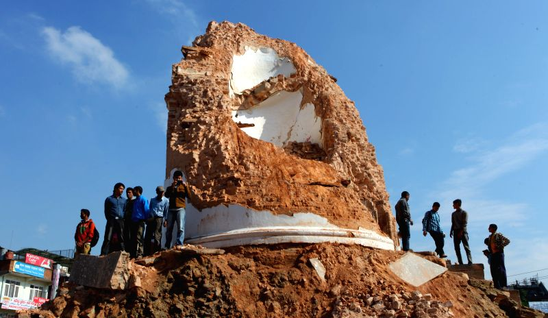 People gather around the damaged Dharahara after a massive earthquake in Kathmandu, Nepal, April 27, 2015. A total of 3,218 people had been killed and about ...