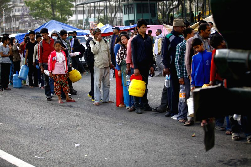 People queue up for water at the Army Pavilion in Tundikhel, Kathmandu, Nepal, April 26, 2015. A total of 3,218 people had been killed and about 6,500 others ...