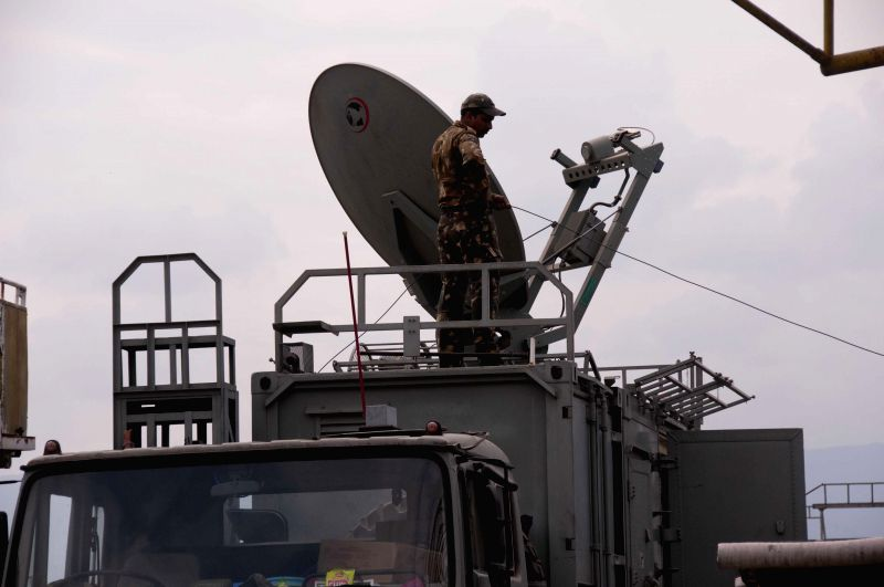 A member of Indian Air Force works on signals at Tribhuvan International Airport in Kathmandu, Nepal, April 28, 2015. The death toll from a powerful earthquake ...