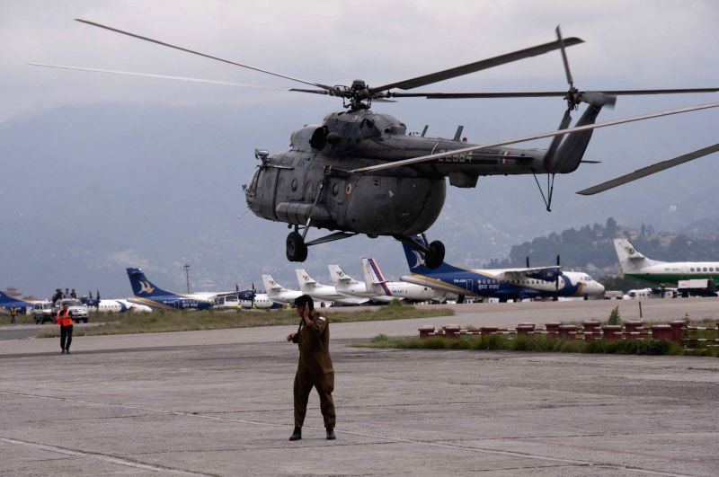 A rescue helicopter flies to earthquake-afftected area from Tribhuvan International Airport in Kathmandu, Nepal, April 28, 2015. The death toll from a powerful ...