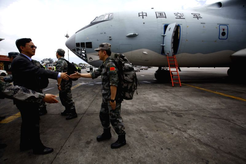 Chinese Ambassador to Nepal Wu Chuntai (L, front) welcomes members of Chinese People's Liberation Army at Tribhuvan International Airport in Kathmandu, Nepal, ...