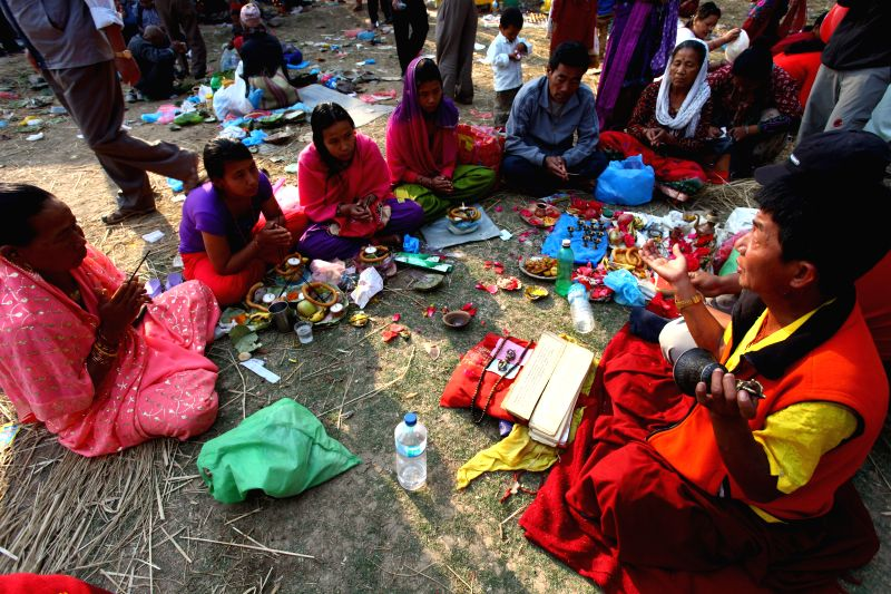 Devotees participate in rituals to pay homage to their mothers on Mata Tirtha Aunsi, or the Mother's Day, in Matatirtha, Nepal, April 29, 2014. (Xinhua/Sunil ...