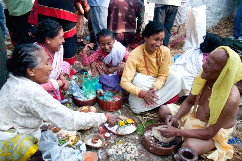 Family members make food to offer their deceased mothers on Mata Tirtha Aunsi or the Mother's Day at Matatirtha, a place near Thankot to the west of downtown ...