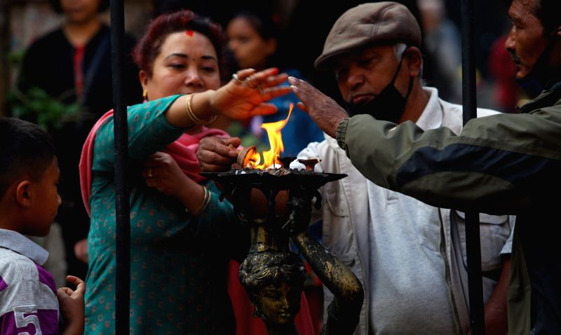 Nepalese people offer prayers in front of a temple in Kathmandu, Nepal, April 29, 2015.