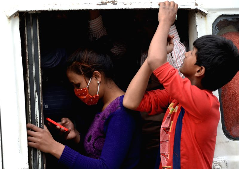 Nepalese residents are seen on a bus to leave Kathmandu at a bus station in Kathmandu, Nepal, on April 29, 2015. The latest figures from the Nepalese government ...