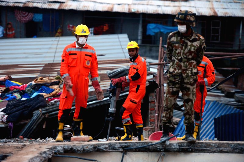 Rescue personnel work on debris in Kathmandu, capitol of Nepal, April 28, 2015. Members of search-and-rescue teams from China, Indonesia and Nepal made efforts ...