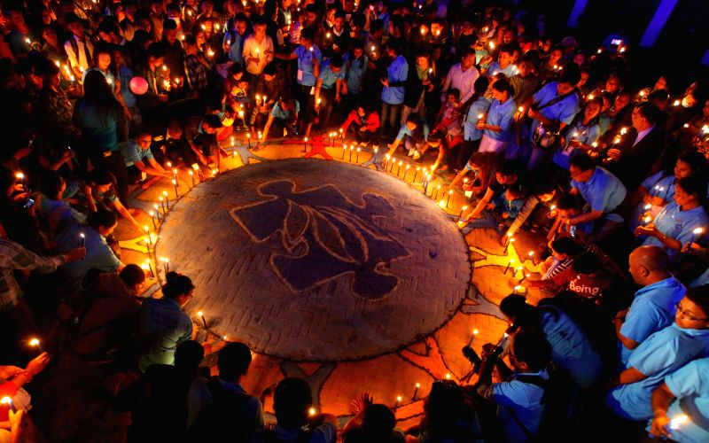 People light up candles during a program organized to celebrate World Autism Awareness Day at Hanumandhoka in Kathmandu, Nepal, April 2, 2015. World Autism ...