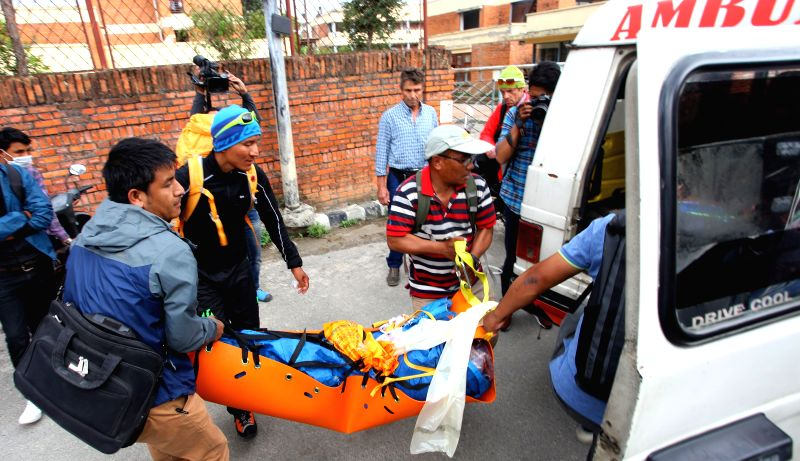 "KATHMANDU, April 30, 2017 - The body of famous Swiss climber Ueli Steck known as ""Swiss Machine"" is carried towards hospital after transported from a helicopter at Teaching Hospital in ..."
