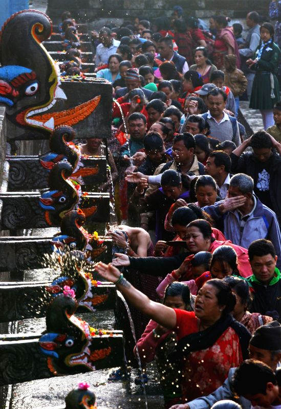 Hindu devotes take holy bath at 22 water spouts (Bais Dhara) during the 22-tap-fair on Baishakh Purnima (full moon day) at Balaju in Kathmadu, Nepal, April 4, ...