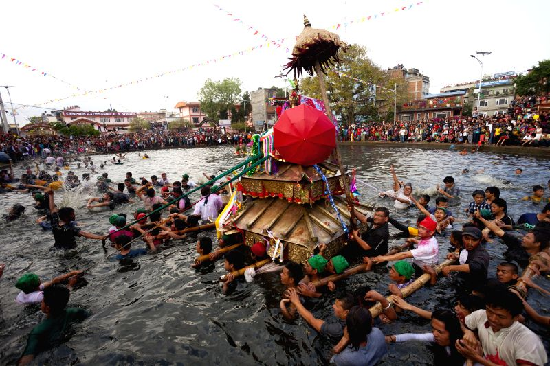 "Local people carry a chariot of Tundaldevi on their shoulders and search for the lost jewellery during the traditional ""Gahana Khojne Jatra"" in Gahana ..."
