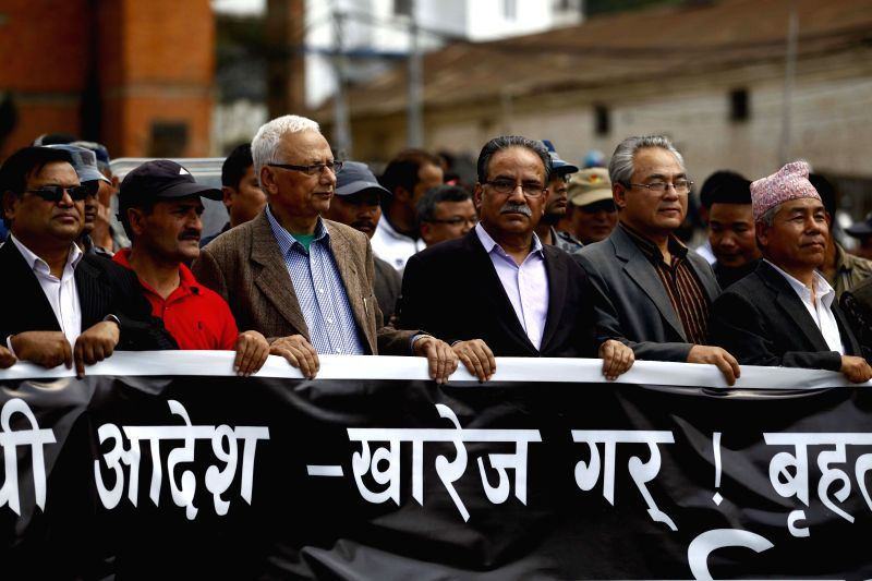 Pushpa Kamal Dahal (3rd R, front), chairman of the Unified Communist Party of Nepal (Maoist), and leaders of various Maoist parties take part in a protest rally ...