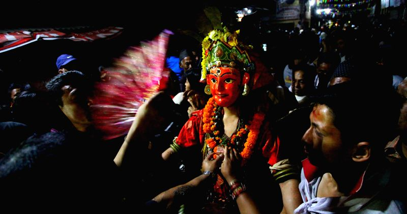 "KATHMANDU, April 7, 2016 - A masked dancer dressed up as deity arrives to perform ""Devi Pyankha"" (Devi Dance in local language) to mark the Ghode Jatra (horse racing festival) in Kathmandu, ..."
