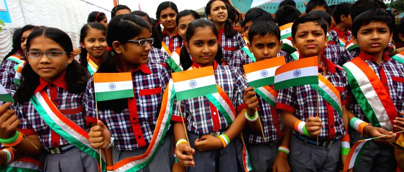 Indian children hold India's national flags to mark the 68th Independence day of India at the Embassy of India in Lainchaur of Kathmandu, Nepal, Aug. 15, 2014. ...
