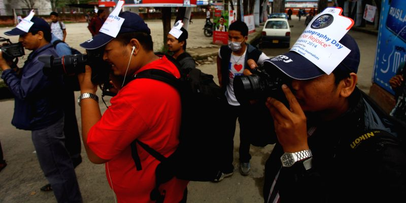 Nepalese photojournalists and photographers participate in a rally to mark the 175th World Photography day in Kathmandu, Nepal, Aug. 19, 2014. The celebration of .