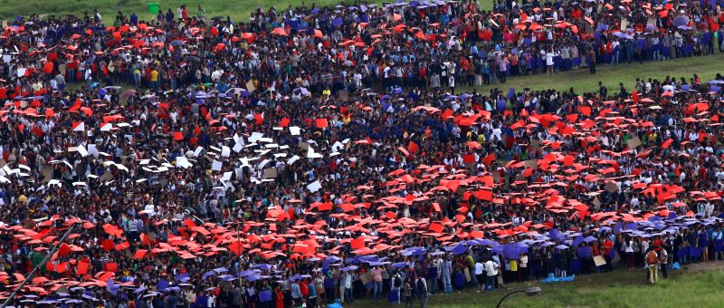 Nepalese people get ready to be part of a human national flag of Nepal to try to break the Guinness World Record of World's Largest Human Flag in Kathmandu, ...