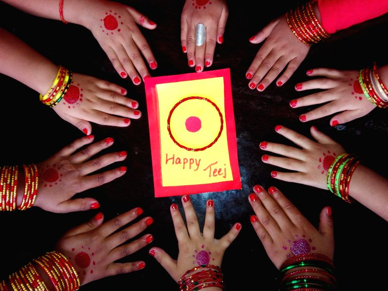 Girls show their decorated hands in the celebration of Teej Festival