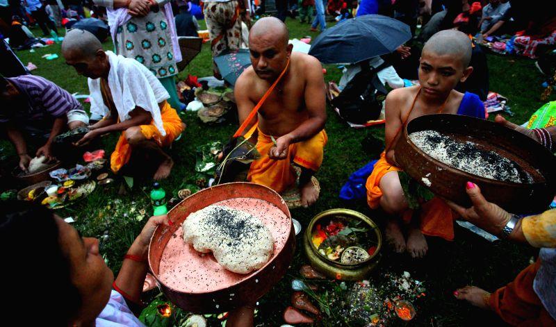 Hindu devotees perform religious rituals on the bank of Bagmati River celebrating Kuse Aunsi at Gokarna Temple in Kathmandu, Nepal, on Aug. 25, 2014. Kuse Aunsi ..