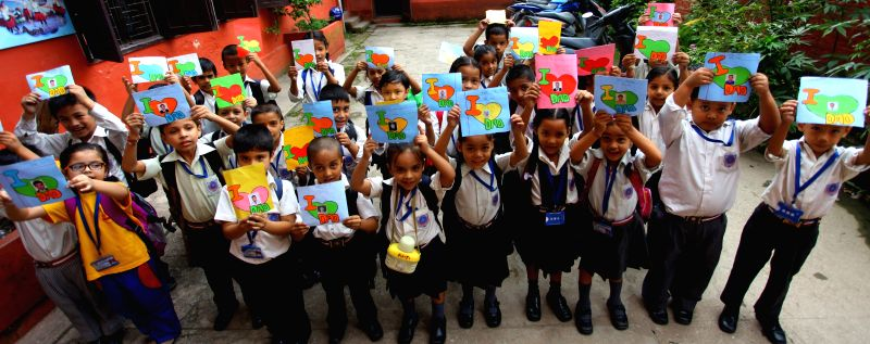 Nepalese children show handmade cards for ther fathers to celebrate the Kuse Aunsi, or Fathers' Day, in Kathmandu, Nepal, on Aug. 25, 2014. The trandtional ...