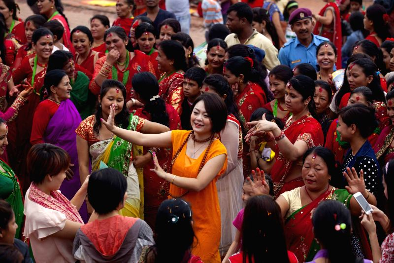Hindu women celebrate the Teej festival in Kathmandu, Nepal, on Aug 27,2014. During the festival , married women fast and pray for good health and long lives of ..