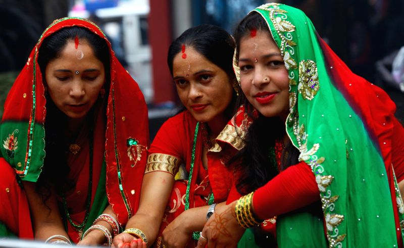 Hindu women offer prayers to Lord Shiva during Teej festival in Kathmandu, Nepal, on Aug 27,2014. During the festival , married women fast and pray for good ...