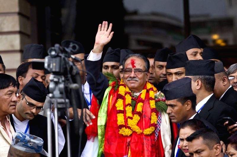 KATHMANDU, Aug. 3, 2016 - Nepal's newly elected Prime Minister Puspa Kamal Dahal (C) waves after winning the election in Kathmandu, Nepal, Aug. 3, 2016. CPN (Maoist Center) Chairman Pushpa Kamal ... - Puspa Kamal Dahal