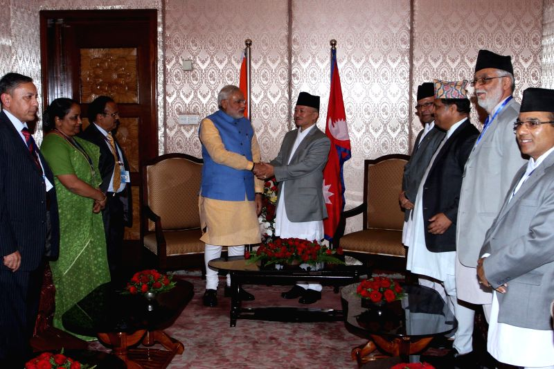Indian Prime Minister Narendra Modi (4th L) shakes hands with the speaker of Legislature Parliament Subhash Chandra Nembang at Constituent Assembly in Kathmandu, .. - Narendra Modi
