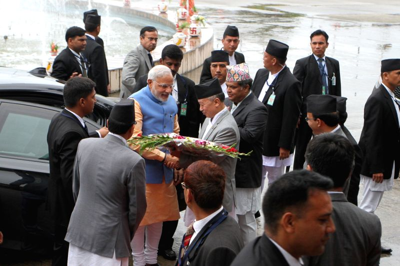 Indian Prime Minister Narendra Modi (in blue) arrives at Constituent Assembly in Kathmandu, Nepal, Aug. 3, 2014. Indian Prime Minister Narendra Modi arrived here .. - Narendra Modi
