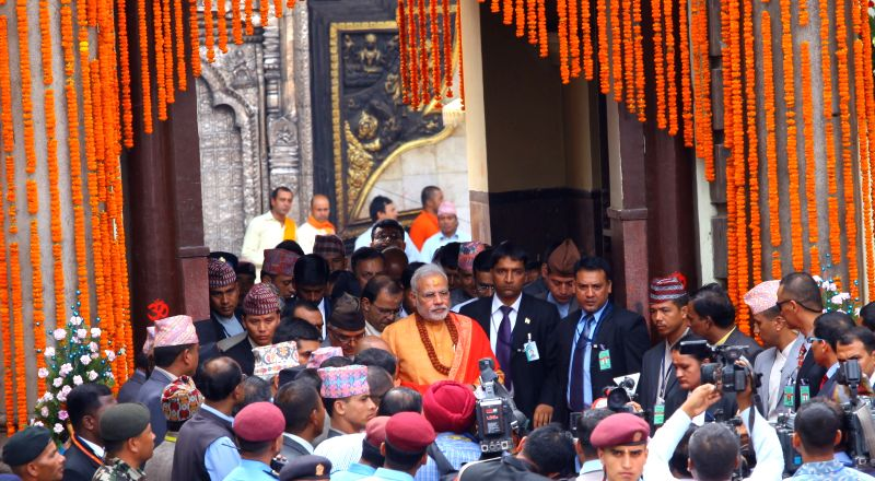 Indian Prime Minister Narendra Modi (C) walks out of Pashupatinath temple after offering his prayers in Kathmandu, Nepal, Aug. 4, 2014. Indian Prime Minister ... - Narendra Modi and Inder Kumar Gujral