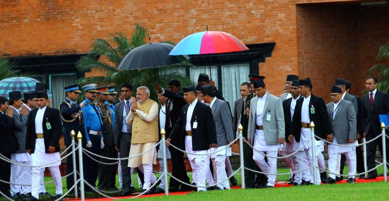 Indian Prime Minister Narendra Modi (C) receives the farewell greetings from Nepalese officers during his departure at Tribhuwan International Airport (TIA) in ... - Inder Kumar Gujral