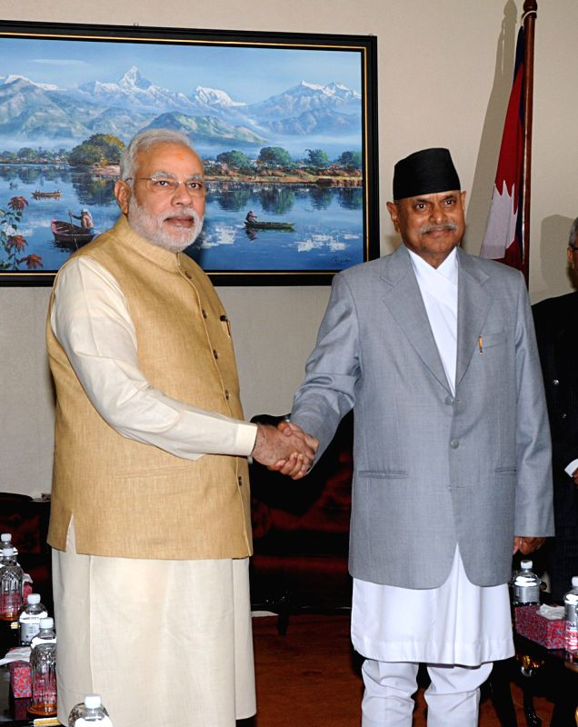 Nepal's President Ram Baran Yadav (R) shakes hands with visiting Indian Prime Minister Narendra Modi at President's office at Shital Niwas in Kathmandu, Nepal, ... - Narendra Modi, Baran Yadav and Inder Kumar Gujral