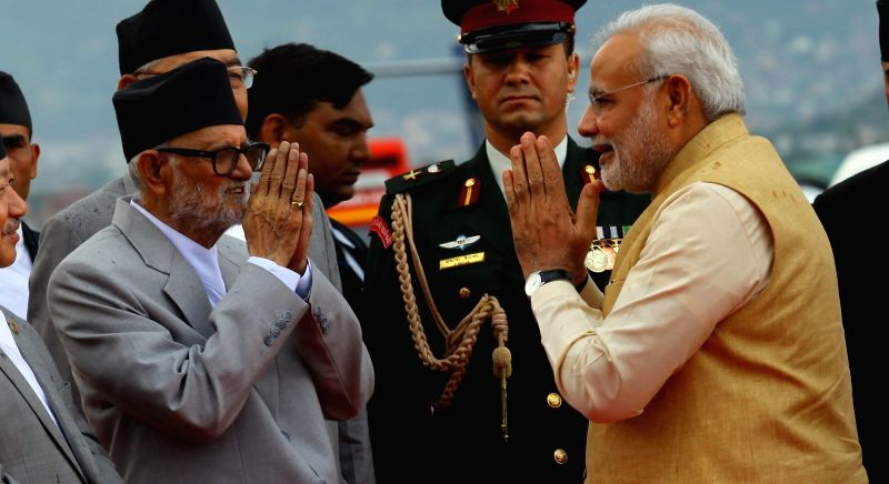 Nepalese Prime Minister Sushil Koirala gives farewell to Indian Prime Minister Narendra Modi (R) during his departure at Tribhuwan International Airport (TIA) in .. - Sushil Koirala and Inder Kumar Gujral