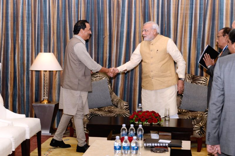 Visiting Indian Prime Minister Narendra Modi shakes hands with Chairman of Rastriya Prajantra Party-Nepal (RPP-N) Kamal Thapa (L) during their meeting in ... - Inder Kumar Gujral