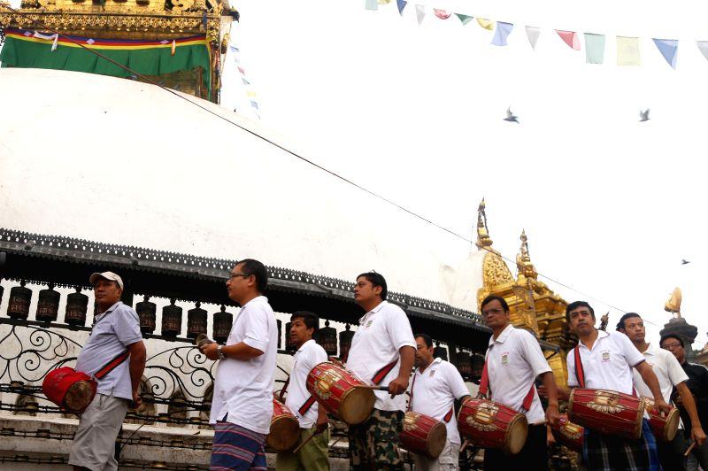 KATHMANDU, Aug. 5, 2016 - People from the Newar community play traditional music during a month-long Gunla festival at Swayambhunath in Kathmandu, Nepal, Aug. 5, 2016. Gunla festival is one of the ...