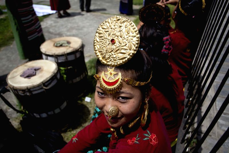 Nepalese indigenous girls attend a program to mark the 20th International Day of the World's Indigenous Peoples in Kathmandu, Nepal, Aug. 9, 2014. The ...