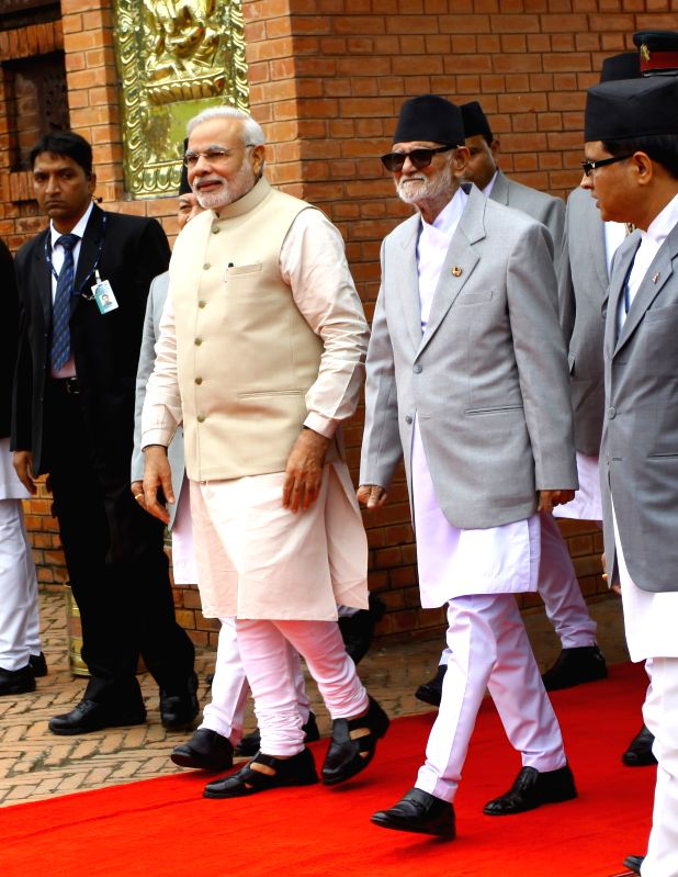 Indian Prime Minsiter Narendra Modi (centrer left) is accompanied by Nepalese Prime Minister Sushil Koirala during the welcoming ceremony at Tribhuwan ... - Sushil Koirala