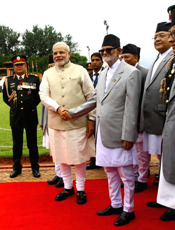 Nepalese Prime Minister Sushil Koirala (front right) welcomes the Indian Prime Minsiter Narendra Modi at Tribhuwan International Airport in Kathmandu, Nepal, ... - Sushil Koirala
