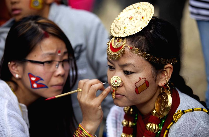 Nepalese girls from Kirat community in traditional costume and ornaments prepare to participate in Udhauli festival in Kathmandu, Nepal, Dec. 14, 2014. Udhauli is