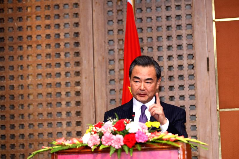 Chinese Foreign Minister Wang Yi speaks during a joint press conference with his Nepalese counterpart Mahendra Bahadur Pandey (not pictured) in Kathmandu, Nepal, . - Wang Y and Mahendra Bahadur Pandey