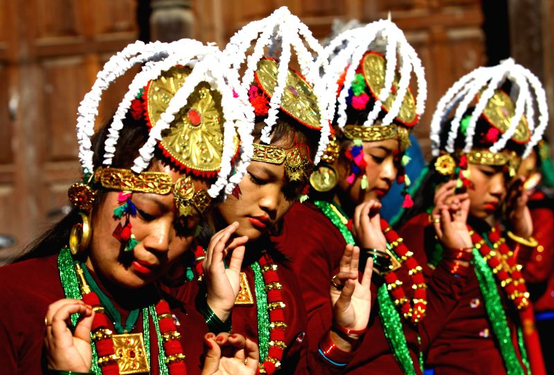 Women from Gurung community dance during the celebration of Tamu Lhosar festival in Kathmandu, Nepal, Dec. 30, 2014. Tamu Lhosar is the celebration of Gurung's ...