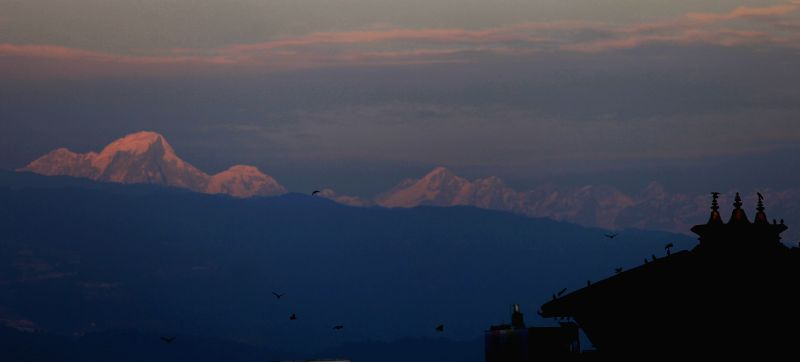 Photo taken on Dec. 31, 2014 shows a mesmerizing view of the Himalayan Range during the last sunset of the year 2014 in Kathmandu, Nepal. (Xinhua/Sunil ...