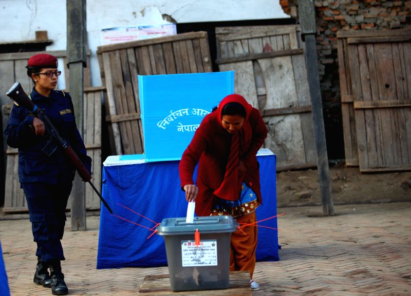 KATHMANDU, Dec. 7, 2017 - A woman casts vote at a polling station during the parliamentary and provincial elections in Kathmandu, Nepal, Dec. 7, 2017. The voting was held in Nepal on Thursday for the ...