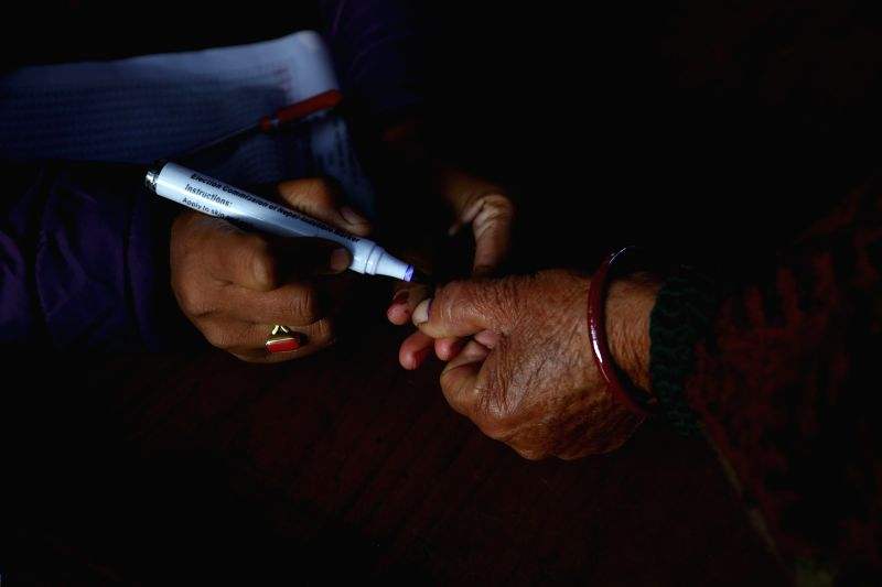 KATHMANDU, Dec. 7, 2017 - A woman gets her thumb inked to cast her vote in the parliamentary and provincial elections at a polling station in Kathmandu, Nepal, Dec. 7, 2017. The voting was held in ...