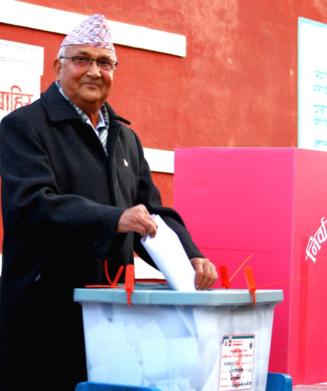 KATHMANDU, Dec. 7, 2017 - Former Nepali Prime Minister K.P Sharma Oli casts his vote at a polling station in Bhaktapur, Nepal, Dec. 7, 2017. The second and final phase of the parliamentary elections ... - K. and P Sharma Oli