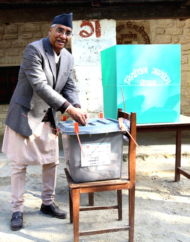 KATHMANDU, Dec. 7, 2017 - Nepali Prime Minister Sher Bahadur Deuba casts his vote at a polling station in Dadeldhura, Nepal, Dec. 7, 2017. The second and final phase of the parliamentary elections is ... - Sher Bahadur Deuba