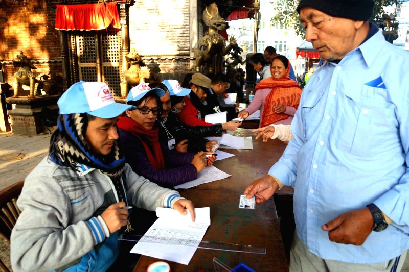 KATHMANDU, Dec. 7, 2017 - People get ready to cast vote at a polling station during the parliamentary and provincial elections in Kathmandu, Nepal, Dec. 7, 2017. The voting was held in Nepal on ...