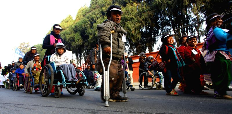 Disabled people take part in a rally for the International day of people with disability in Kathmandu, Nepal, Dec. 3, 2014. The rally was organized to promote understanding and support for