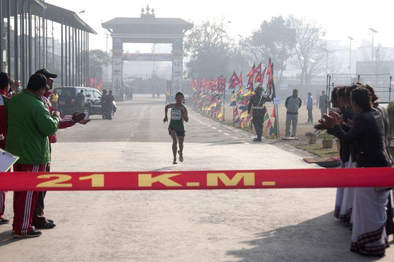 KATHMANDU, Feb. 11, 2017 - A participant runs towards the finish line in the CoAS Open Marathon 2017 in Kathmandu, Nepal, Feb. 11, 2017. Nearly 2,000 people participated in the marathon.