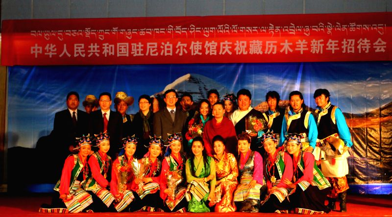 Ambassador of China to Nepal Wu Chuntai (6th L, rear) poses for photos with performers after a cultural show organized to mark the Chinese Tibetan Losar in ...