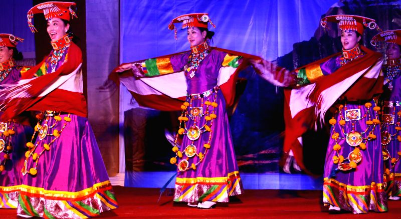 Performers dressed in traditional attire dance during a cultural show organized to mark the Chinese Tibetan Losar in Kathmandu, Nepal, Feb. 12, 2015. ...